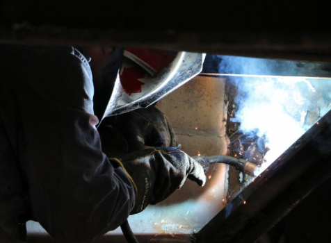 Man working sparkling Welding